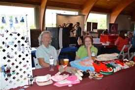 Two Women at the Crafty Seniors Booth