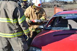 Firefighter Drilling into Car During Extrication Training