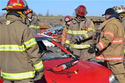 Group of Firemen Performing Extrication Training